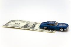 Automobile del giocattolo e un dollaro Fotografie Stock Libere da Diritti
