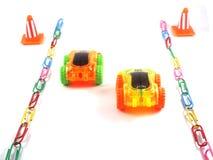 Automobile del giocattolo sul modo Fotografie Stock Libere da Diritti