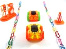 Automobile del giocattolo sul modo Immagini Stock Libere da Diritti