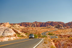 Automobile on desert highway Stock Image