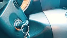 Automobile di inizio di Person Hand Inserting Key To video d archivio