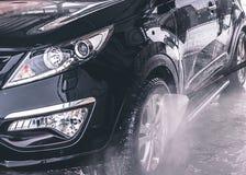 Automobile di lavaggio Fine in su Acqua ad alta pressione Fotografie Stock