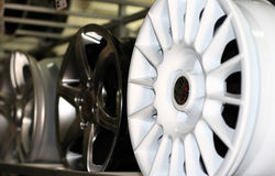 Automobile disk. White automobile disk on a background of other disks Royalty Free Stock Photography