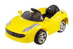 Automobile a distanza gialla del giocattolo del regolatore isolata Immagine Stock Libera da Diritti