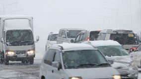 Automobile driving on road in city during heavy blizzard snowstorm. PETROPAVLOVSK-KAMCHATSKY CITY, KAMCHATKA PENINSULA, RUSSIA - JANUARY 12, 2017: Winter urban stock footage