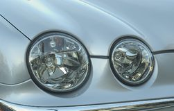 Automobile Dual Headlight. Modern automobile headlight stock images