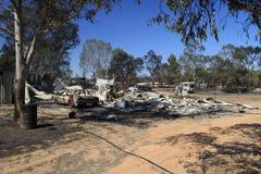 Automobile e casa distrutte Fotografia Stock