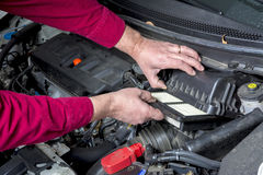 Automobile filter replacement Stock Photo