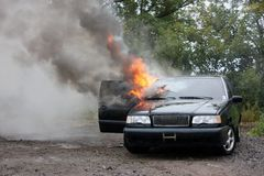 Automobile fire. An automobile with the interior engulfed in fire Royalty Free Stock Photography