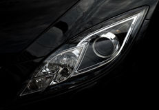 Automobile front optics. From new car Royalty Free Stock Photography