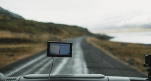 Automobile front view with digital navigation gadget, journey vacation concepts Stock Photo