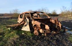 Automobile fuori bruciata rubata Immagini Stock