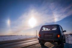 Automobile fuori strada russa Lada Niva ed alone - fenomeno ottico immagine stock libera da diritti