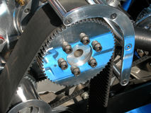 Automobile gear and belt. Close-up of gear and timing belt on classic hot rod car stock images