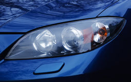 Automobile headlamp of a modern car. Automobile headlamp of a modern car, photographed in close-up Stock Photography