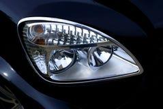 Automobile headlight. Forward headlight of the modern car Stock Photos