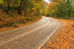 Automobile highway in the mountains, dangerous turns. Autumn landscape stock images