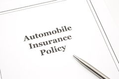 Automobile Insurance Policy with a Pen Stock Images