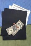 Automobile insurance savings. Saving money on car insurance Stock Photo