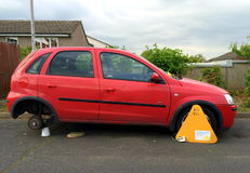 Automobile misura con il morsetto di ruota Fotografia Stock