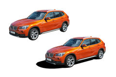Automobile moderna arancio BMW X1 Fotografie Stock Libere da Diritti