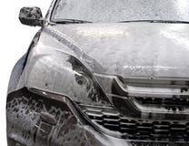 Automobile moderna coperta da schiuma Fotografia Stock