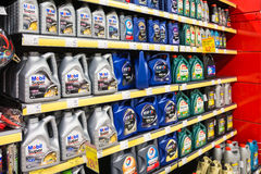 Automobile Motor Oil On Supermarket Shelf. BUCHAREST, ROMANIA - JANUARY 22, 2014: Automobile Motor Oil On Supermarket Shelf. Motor oil or engine oil is an oil Royalty Free Stock Images