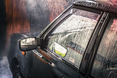 Automobile nel lavaggio Fotografia Stock
