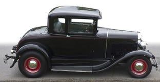 Automobile nera isolata dell'annata Fotografie Stock Libere da Diritti