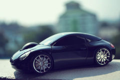 Automobile nera nel retro concetto Fotografia Stock