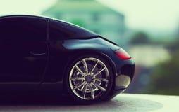 Automobile nera nel retro concetto Immagine Stock
