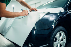 Automobile paint protection film installation Royalty Free Stock Photo