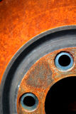 Automobile Part. Section of automobile part (brake rotor) makes interesting shape and color detail. Use for any automotive buisness, repair, service etc royalty free stock photo