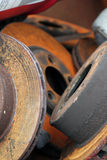 Automobile Parts. Discarded automobile parts in a scrap bin make an interesting play of color and shape. Shallow DOF stock photography