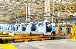 Automobile production line. Car production line, skilled workers are working tense royalty free stock image