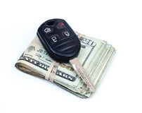 Automobile purchase. Money and car key. Royalty Free Stock Image