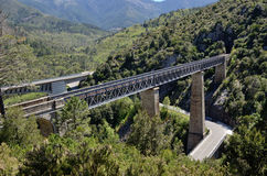 Automobile and railway bridge in the Corsican mountains Stock Photos