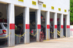Auto repair garage with vehicles on lifts Royalty Free Stock Photo