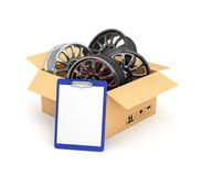Automobile rims in an open cardboard Royalty Free Stock Photography