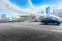 Automobile road background. Driving fast in the city of cars on the road and pedestrian bridge Royalty Free Stock Image