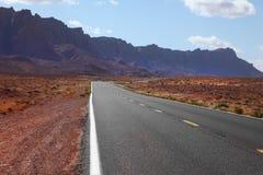 Automobile road to desert Stock Photo