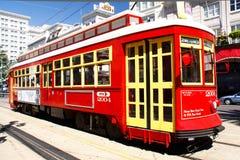 Automobile rossa del Canal Street di New Orleans Immagine Stock