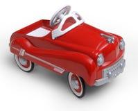 automobile rossa del giocattolo di era degli anni 50 immagine stock