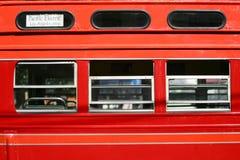 Automobile rossa della via Immagine Stock