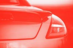 Automobile rossa di pendenza di sport alla moda Frammento, dettagli Foto tonificata rossa fotografia stock