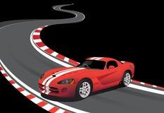 Automobile rossa sulla pista di corsa Immagini Stock