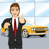 Automobile salesman holding the key Royalty Free Stock Photography