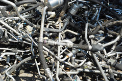 Automobile scrapheap pipework. Automobile scrap heap used pipework closeup as background royalty free stock photo