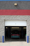 Automobile Service Bay. Mechanics at work in modern auto service shop stock photos