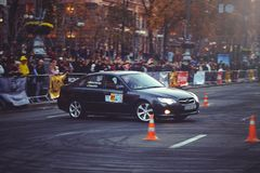 Automobile slalom and drift competitions in the city center, car on the road with cones Royalty Free Stock Image